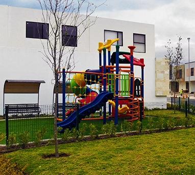 Foto de juegos infantiles en Lenna Residencial, en Zákia, Querétaro.